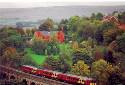 Photograph. Taken from Ladcastle Road looking down onto the railway viaduct at Brownhill, Uppermill.