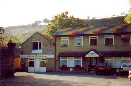 Photograph. This building off of Wade Row, Uppermill has been demolished